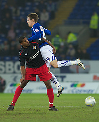 CARDIFF, WALES - Tuesday, February 1, 2011: Cardiff City's Aaron Ramsey and Reading's Mikele Leigertwood in action during the Football League Championship match at the Cardiff City Stadium. (Photo by Gareth Davies/Propaganda)
