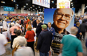 Berkshire Hathaway shareholders walks by a photo of CEO Warren Buffett at the shareholder shopping day as part of the Berkshire Hathaway annual meeting weekend in Omaha, Nebraska May 5 2017. REUTERS/Rick Wilking