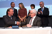 Koningin Maxima is aanwezig bij de ondertekening lening Europese Investeringsbank aan Qredits in de Hermitage, Amsterdam .<br /> <br /> Queen Maxima was present at the signing loan European Investment Bank Qredits  in the Hermitage, Amsterdam .<br /> <br /> op de foto / On the photo:  De heer Elwin Groenevelt en Drs. P. van Ballekom tekenen de overeenkomst. Koningin M&aacute;xima, Minister Kamp en Dr. Hoyer zijn op het podium getuige van de ondertekening van de EIB-lening ///// Mr. Elwin Freek and Drs. P. van Ballekom sign the agreement. Queen M&aacute;xima, Minister Kamp and Dr. Hoyer on stage witnessed the signing of the EIB loan