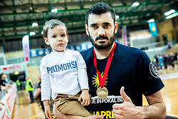 Marko Jagodic Kuridza of Sixt Primorska and his child celebrate after winning during basketball match between KK Sixt Primorska and KK Hopsi Polzela in final of Spar Cup 2018/19, on February 17, 2019 in Arena Bonifika, Koper / Capodistria, Slovenia. KK Sixt Primorska became Slovenian Cup Champion 2019. Photo by Vid Ponikvar / Sportida