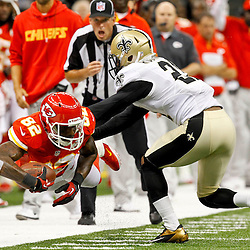 September 23, 2012; New Orleans, LA, USA; Kansas City Chiefs wide receiver Dwayne Bowe (82) drives past New Orleans Saints cornerback Patrick Robinson (21) and past the first down marker during overtime of a game at the Mercedes-Benz Superdome. The Chiefs defeated the Saints 27-24 in overtime. Mandatory Credit: Derick E. Hingle-US PRESSWIRE