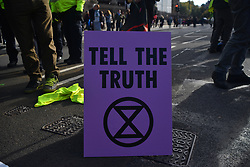 October 31, 2018 - London, United Kingdom - People gather outside the Parliament, blocking the traffic in a pacific protest, asking for the British Government to take action against climate change, London on October 31, 2018. (Credit Image: © Alberto Pezzali/NurPhoto via ZUMA Press)