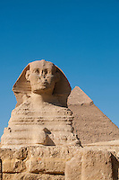 The Sphinx with a pyramid directly behind it at Giza, Egypt.
