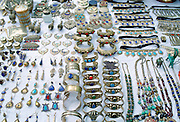 Silver jewels - necklaces, bangles, bracelets, earrings, pendants with semi-precious stones - on display at a market in Pakistan