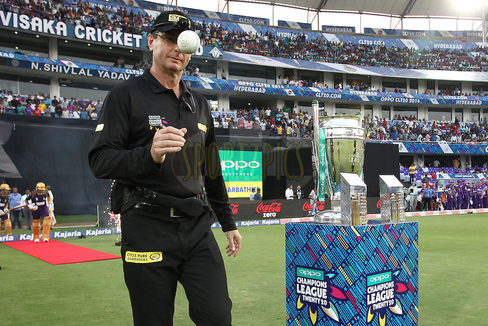 Umpire Rod Tucker walks out for the Kolkata Knight Riders innings during the first semi final match of the Oppo Champions League Twenty20 between the Kolkata Knight Riders and the Hobart Hurricanes held at the Rajiv Gandhi Cricket Stadium, Hyderabad, India on the 2nd October 2014<br /> <br /> Photo by:  Shaun Roy / Sportzpics/ CLT20<br /> <br /> <br /> Image use is subject to the terms and conditions as laid out by the BCCI/ CLT20.  The terms and conditions can be downloaded here:<br /> <br /> http://sportzpics.photoshelter.com/gallery/CLT20-Image-Terms-and-Conditions-2014/G0000IfNJn535VPU/C0000QhhKadWcjYs