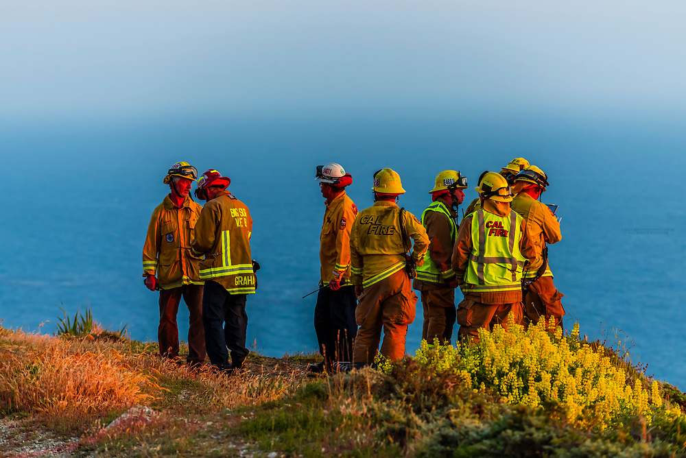 Emergency vehicles respond to a vehicle intentionally driving off a huge cliff (the driver had committed suicide) near Hurricane Point, on the Big Sur coast between Carmel Highlands and Big Sur, California, USA.