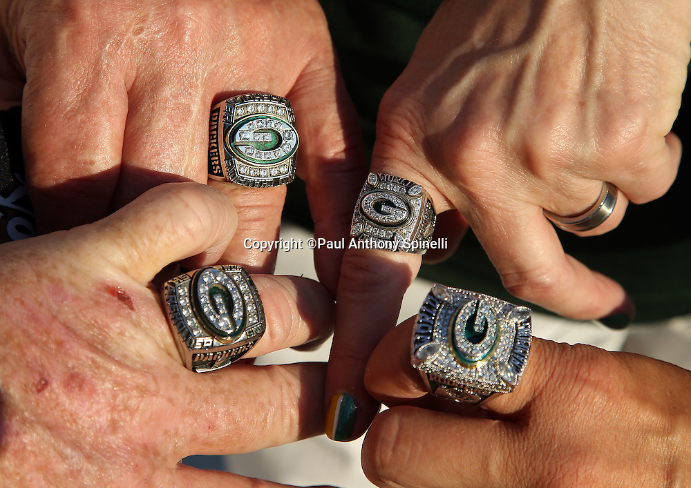 A group of Green Bay Packers fans, show off their Super Bowl rings before the New Orleans Saints NFL week 8 regular season football game against the Green Bay Packers on Sunday, Oct. 26, 2014 in New Orleans. ©Paul Anthony Spinelli