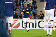 Theo Walcott of Arsenal warms up before the Champions League group match between Montpellier and Arsenal at the Stade la Mosson, Montpellier, France, 18th September 2012. Eoin Mundow/Cleva Media