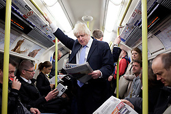 © Licensed to London News Pictures. 03/05/2012. LONDON, UK. London Mayor Boris Johnson reads a newspaper as he travels on the Northern Line after casting his vote in the 2012 mayoral and council elections in London today (03/05/12). Photo credit: Matt Cetti-Roberts/LNP