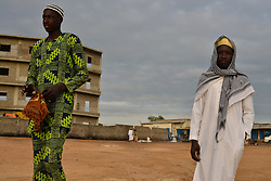 June 25, 2017 - Juba, Jubek, South Sudan - Young men arrive at the Malkei neighborhood in Juba, South Sudan to attend prayers Sunday as the Muslim world celebrates the start of Eid Al-Fitr and the end of Ramadan.Roughly half of the population of South Sudan, the world's newest nation and one now devastated by civil war, embraces Islam. (Credit Image: © Miguel Juarez Lugo via ZUMA Wire)