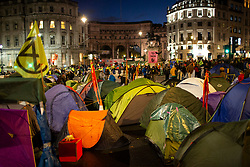 © Licensed to London News Pictures. 08/10/2019. London, UK. Extinction Rebellion protesters erect tents and gazebos in Trafalgar Square . Police continue to attempt to clear roads in Westminster on the second day of the protest . Photo credit: George Cracknell Wright/LNP