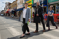 London, UK. 22 May, 2019. Caroline Lucas, Green Party MP for Brighton Pavilion, campaigns for the European elections in Peckham with Scott Ainslie, who tops the Green Party list in London, and Eleanor Margolies.