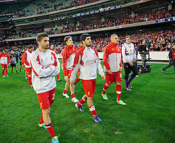 MELBOURNE, AUSTRALIA - Wednesday, July 24, 2013: Liverpool's Fabio Borini, Luis Suarez and Martin Skrtel after their side's 2-0 victory over Melbourne Victory during a preseason friendly match at the Melbourne Cricket Ground. (Pic by David Rawcliffe/Propaganda)