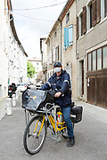 postman delivering mail during the Covid 19 crisis and lockdown France Limoux April 2020