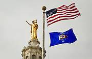 """MADISON, WI – DECEMBER 19: The """"Wisconsin"""" statue sits atop the Wisconsin State Capitol on Monday, December 19, 2016. At Noon, Wisconsin Presidential electors met in the Capitol building to cast their ten electoral votes for Donald J. Trump."""