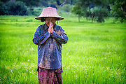 Lut, a rice field worker, says goodbye as she heads for home after a day of planting rice in Nakhon Nayok ‪Thailand‬ Aug 16, 2016. PHOTO BY LEE CRAKER