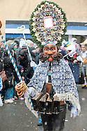 Imst Schemenlaufen, a traditional carnival held only once every four years in Imst, Tirol, Austria (31 January 2016). The Schemenlaufen is inscribed on the UNESCO list of Intangible Cultural Heritage. Pictured here, one of the Scheller (the Scheller are one of the main 'characters' in Schemenlaufen), with cattle bells round his waist. © Rudolf Abraham