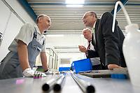 23 JUL 2010, NEUSTADT-GLEWE/GERMANY:<br /> Erwin Sellering (R), SPD, Ministerpraesident Mecklenburg-Vorpommern, im Gespraech mit einem Mitarbeiter, Betriebsbesuch bei der Firma Dockweiler AG im Rahmen der Sommertour<br /> IMAGE: 20100723-01-051<br /> KEYWORDS: Sommerreise
