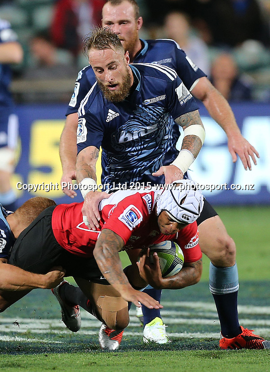 Blues` Jimmy Cowan tackles Lions` Lionel Mapoe in the Super Rugby Match, Blues v Lions, QBE Stadium, Albany, Auckland, New Zealand, Saturday, March 07, 2015. Copyright photo: David Rowland/www.photosport.co.nz