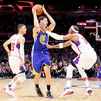 19 November 2015: Golden State Warriors guard Klay Thompson (11) drives past Los Angeles Clippers guard Austin Rivers (25) and Los Angeles Clippers forward Paul Pierce (34) during the Golden State Warriors 124-117 victory over the Los Angeles Clippers, at the Staples Center, Los Angeles, California, USA.
