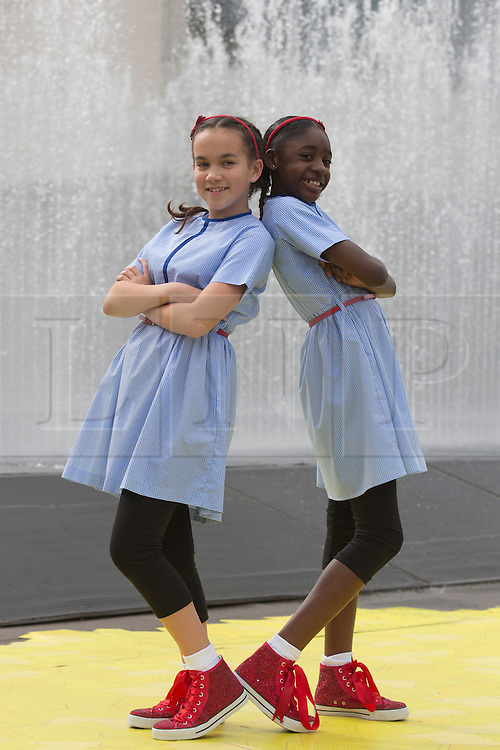 "© Licensed to London News Pictures. 07/08/2013. London, England. L-R: Arizona Snow, 12, and Portia Oti, 11, as Dorothy. ZooNation Dance Company return to the Southbank Centre with the world premiere of ""Groove on Down the Road"", a hip hop take on the ""Wizard of Oz"" story. With Portia Oti and Arizona Snow as Dorothy, Michael McNeish as Toto, Jaih Betote Dipito as Scarecrow, Michael Ureta as Tin Man and Corey Culverwell as Lion. Photo credit: Bettina Strenske/LNP"