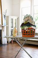 Laundry basket on ironing board