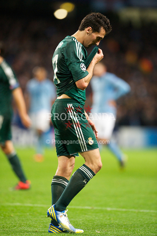 MANCHESTER, ENGLAND - Wednesday, November 21, 2012: Real Madird CF's Alvaro Arbeloa walks off dejected after being sent off against Manchester City during the UEFA Champions League Group D match at the City of Manchester Stadium. (Pic by David Rawcliffe/Propaganda)