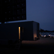 A single staff member operates the screening from a control room set up inside a trailer. With the sessions on hold due to new restrictions on social gatherings, most of the staff will be out of work for the time being. Dublin, Ireland - March 23, 2020.