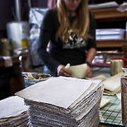 Mychal Mitchell, bookbinder, of Iona Handcrafted Books in Austin, Texas