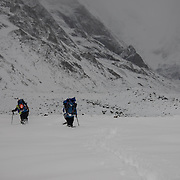 After a massive, late-monsoon storm that dumped nearly three feet of snow on the Gangotri, David Morton and Pete McBride make their way back down valley.
