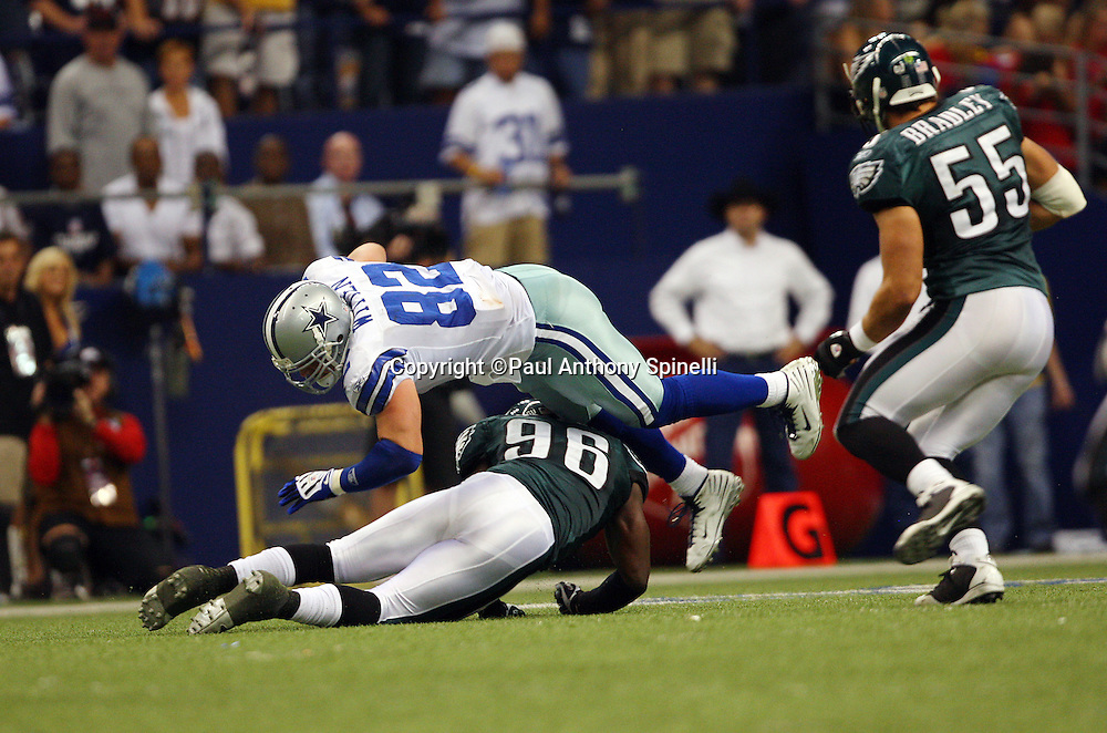 IRVING, TX - SEPTEMBER 15:  Linebacker Omar Gaither #96 of the Philadelphia Eagles submarine tackles tight end Jason Witten #82 of the Dallas Cowboys at Texas Stadium on September 15, 2008 in Irving, Texas. The Cowboys defeated the Eagles 41-37. ©Paul Anthony Spinelli *** Local Caption *** Omar Gaither;Jason Witten
