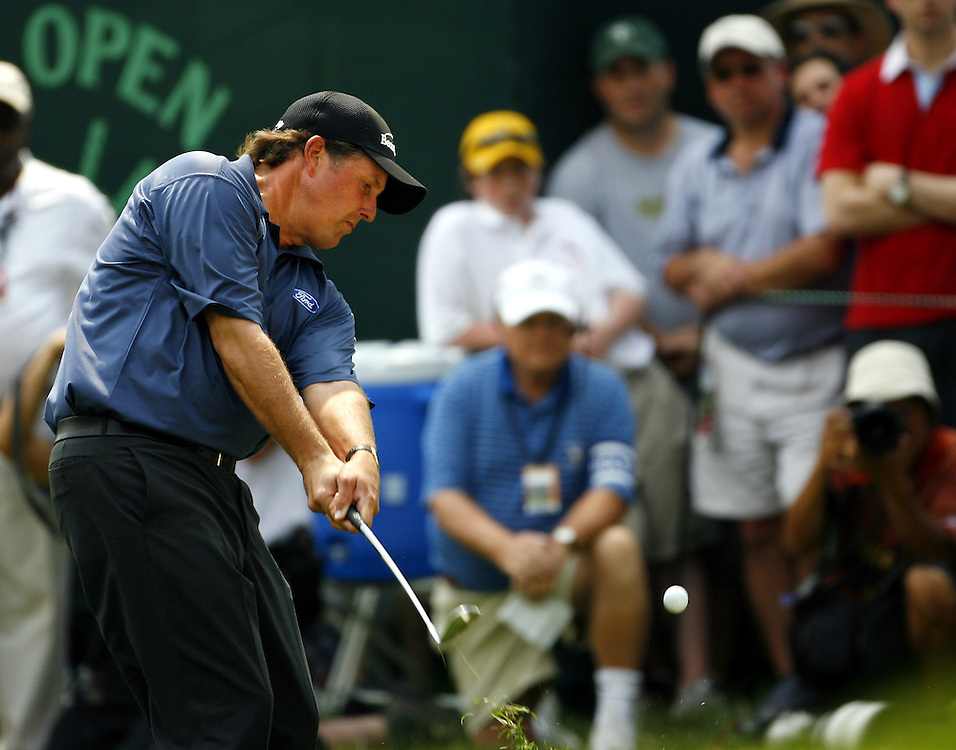 Phil Mickelson of the US chips from the rough on the second hole during the third day of the US Open Golf Championship at Winged Foot Golf Club in Mamaroneck, New York Saturday, 17 June 2006. .