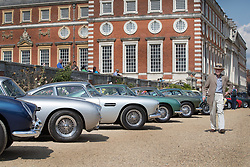 © Licensed to London News Pictures. 02/09/2017. London, UK. Visitors to the Concours of Elegance show admire a long line up of Aston Martins on display in the grounds of Hampton Court Palace. The Concours of Elegance brings together, over three days, a selection of 60 of the rarest cars from around the world some of which have never been seen before in the UK. Each car owner is asked to vote on the other models on display to decide which car is considered to be the 'Best of Show'. The show also displays of hundreds of other fine motor cars, including entrants to The Club Trophy. Photo credit: Peter Macdiarmid/LNP