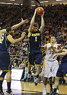 February 19 2011: Michigan Wolverines guard Stu Douglass (1) pulls in a rebound during the first half of an NCAA college basketball game at Carver-Hawkeye Arena in Iowa City, Iowa on February 19, 2011. Michigan defeated Iowa 75-72 in overtime.