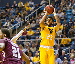 Dec 21, 2015; Morgantown, WV, USA; West Virginia Mountaineers forward Esa Ahmad (23) shoots during the first half against the Eastern Kentucky Colonels at the WVU Coliseum. Mandatory Credit: Ben Queen-USA TODAY Sports