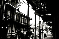 Horse-drawn carraige makes way down Toulouse Street on rainy day in New Orleans, LA.  Copyright 2011 Reid McNally.