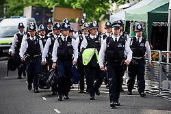 © Licensed to London News Pictures. 29/08/2016. London, UK. A heavy police presence on day two of the Notting Hill carnival, the second largest street festival in the world after the Rio Carnival in Brazil, attracting over 1 million people to the streets of West London.  Photo credit: Ben Cawthra/LNP