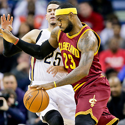 Dec 12, 2014; New Orleans, LA, USA; Cleveland Cavaliers forward LeBron James (23) drives past New Orleans Pelicans guard Austin Rivers (25) during the first quarter of a game at the Smoothie King Center. Mandatory Credit: Derick E. Hingle-USA TODAY Sports