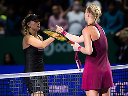 October 23, 2018 - Kallang, SINGAPORE - Angelique Kerber of Germany & Kiki Bertens of the Netherlands at the net after their match at the 2018 WTA Finals tennis tournament (Credit Image: © AFP7 via ZUMA Wire)