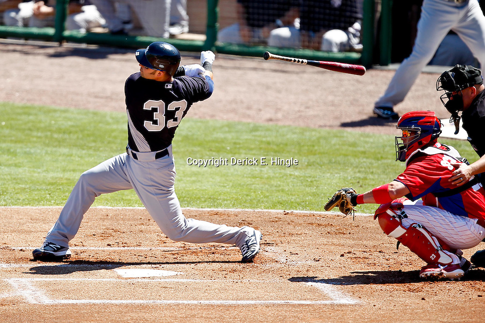 March 05, 2011; Clearwater, FL, USA; New York Yankees right fielder Nick Swisher (33) loses his bat while swinging during a spring training game against the Philadelphia Phillies at Bright House Networks Field. Mandatory Credit: Derick E. Hingle-US PRESSWIRE