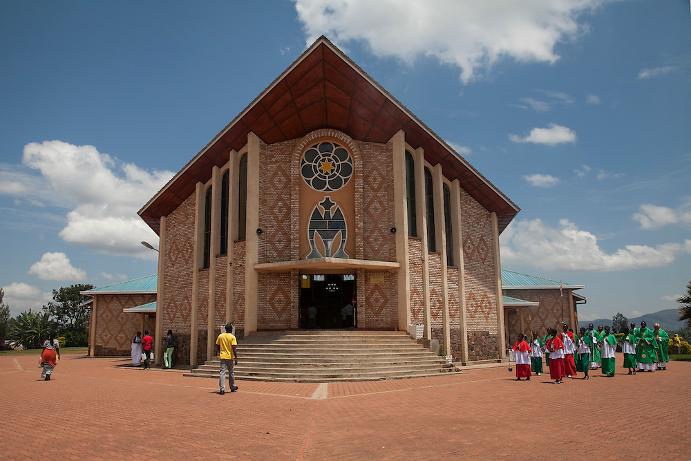 Procession into mass at The Shrine of Our Lady of Sorrows in Kibeho, Rwanda, on Sunday, October 26, 2014. This is the only sanctioned Marian sanctuary in Africa. Kibeho's overseers and the Rwandan government hope this place will become a top tourism site. The Virgin Mary appeared here in 1981to three young women, one of whom still lives near the church grounds.<br /> <br /> Photo by Laura Elizabeth Pohl