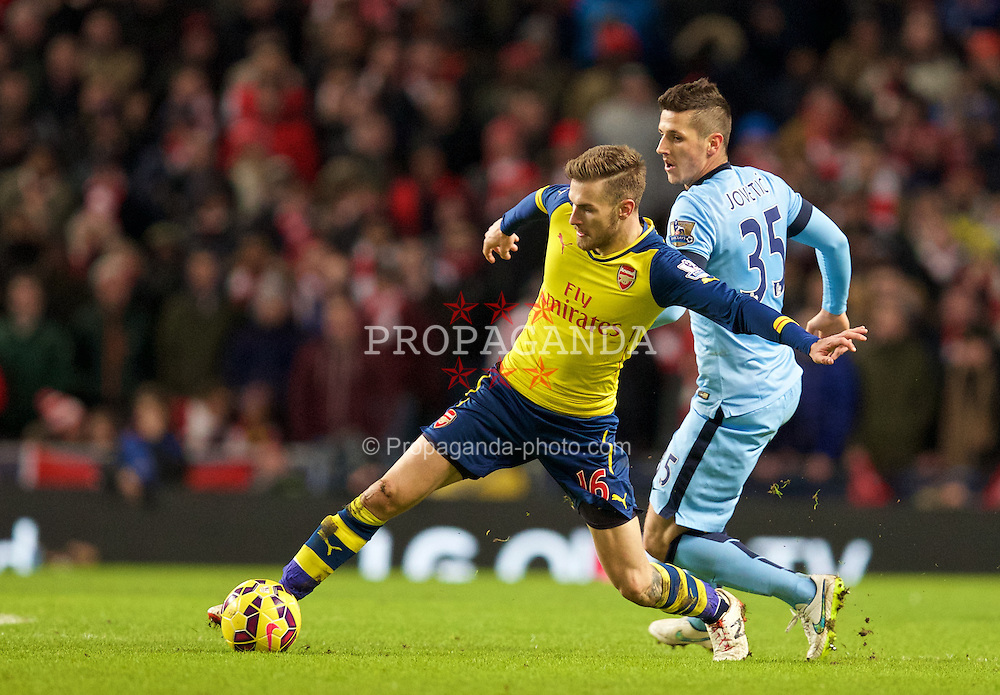 MANCHESTER, ENGLAND - Sunday, January 18, 2015: Arsenal's Aaron Ramsey in action against Manchester City during the Premier League match at the City of Manchester Stadium. (Pic by David Rawcliffe/Propaganda)