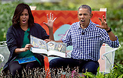 "President Barack Obama and First Lady Michelle Obama read the book ""Where The Wild Things Are"" during the 138th White House Easter Egg Roll at the White House."