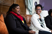 Qiana Holmes Abanukam, left, speaks during their book club meeting in Sun Prairie, Wisconsin, Friday, Oct. 26, 2018.