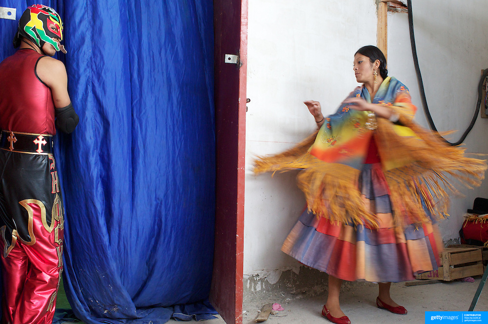 Yolanda La Amorosa (right) warms up in the dressing room as she prepares for her bout during the 'Titans of the Ring' wrestling group's Sunday performance at El Alto's Multifunctional Centre. Bolivia. The wrestling group includes the fighting Cholitas, a group of Indigenous Female Lucha Libra wrestlers who fight the men as well as each other for just a few dollars appearance money. El Alto, Bolivia, 14th March 2010. Photo Tim Clayton