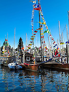 2014 Swiftsure International Yacht Race, Victoria, British Columbia, Canada.  A festive atmosphere in Victoria Harbour the day before the start, with Dragonfly, a Formula 40 catamaran in the foreground. Olympus Tough TG-1.