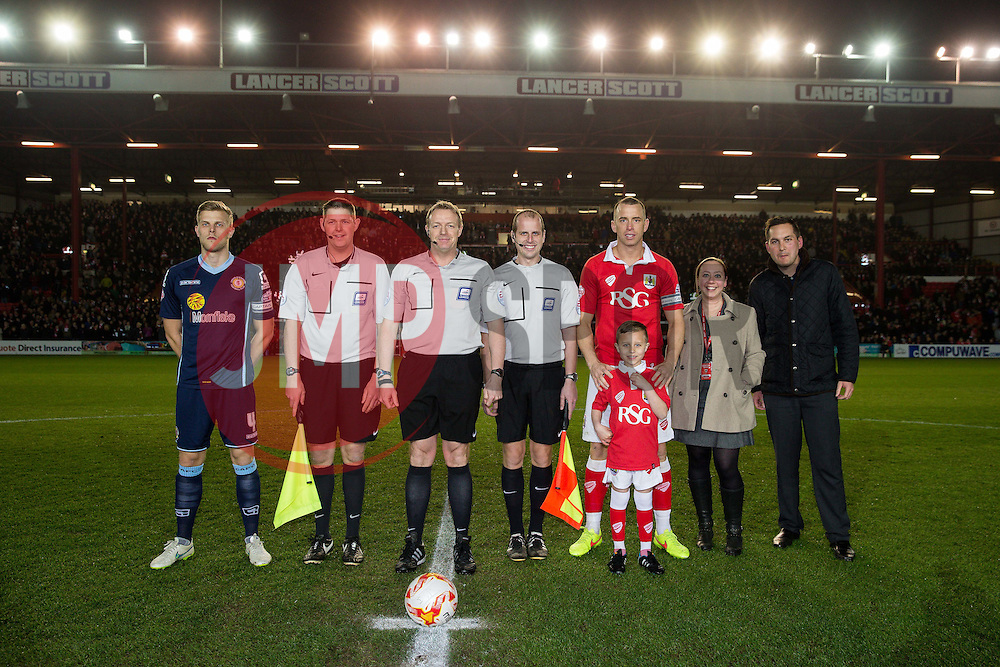 Captains Harry Davis of Crewe Alexandra and Aaron Wilbraham of Bristol City pose before kick off with the match mascot, referee Trevor Kettle and his assistants - Photo mandatory by-line: Rogan Thomson/JMP - 07966 386802 - 17/03/2015 - SPORT - FOOTBALL - Bristol, England - Ashton Gate Stadium - Bristol City v Crewe Alexandra - Sky Bet League 1.