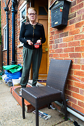 Widow Ann Anderson who had her partially toothless little Yorkshire Terrier Albert 'arrested' by the police after it was alleged her dog had attacked a post office worker, stands by the chair outside her front door where her Yorkie used to sit and watch the street. . London, September 10 2018.
