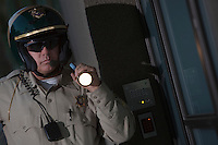 Nightwatch patrolman with flashlight