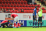 Nottingham Forest forward Sammy Ameobi (19) is given a yellow card by referee, Oliver Langford after a foul on Charlton Athletic defender Adedeji Oshilaja (4) during the EFL Sky Bet Championship match between Charlton Athletic and Nottingham Forest at The Valley, London, England on 21 August 2019.